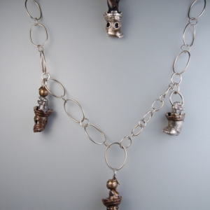 Surreal Necklace with Baby Booties and Piggy Angel Tower